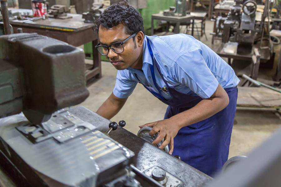 Gulshan Burh works at a milling machine at Don Bosco Technical School.