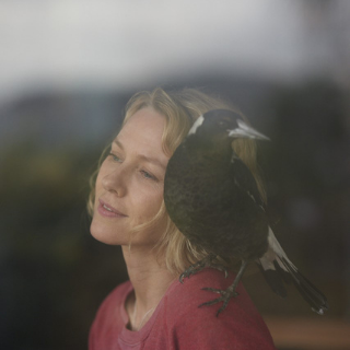 Naomi Watts with a magpie on her shoulder