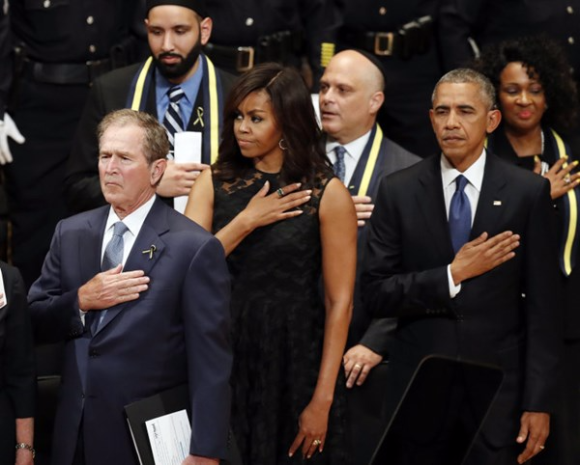 Former President George W. Bush, first lady Michelle Obama, and President Barack Obama in Dallas yesterday. Eric Gay / AP Photo