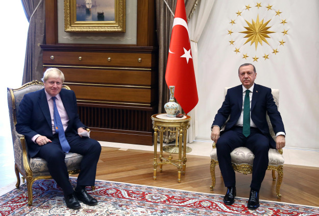 See, Erdogan probably doesn't even remember it. Just look at the ease at which they sit together in this photo on Tuesday.