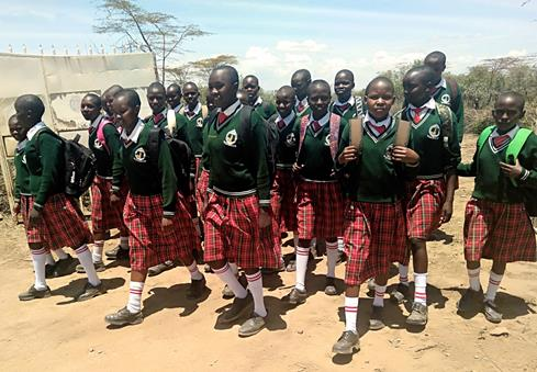 Girls rescued from FGM by TNI walk to school on the first day of the current term, September 2019